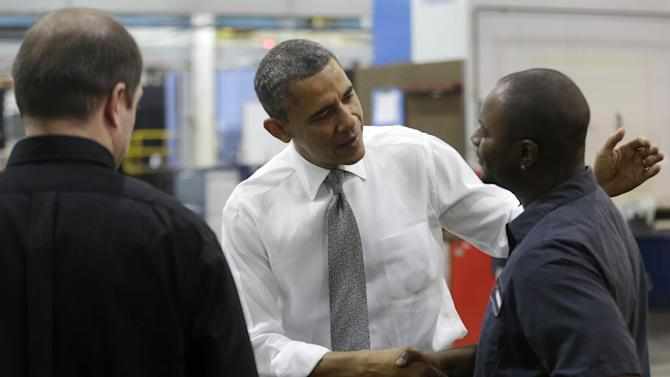 President Barack Obama greets workers as he visits Linamar Corporation in Arden, N.C., the day after delivering his State of the Union address, Wednesday, Feb. 13, 2013. (AP Photo/Charles Dharapak)