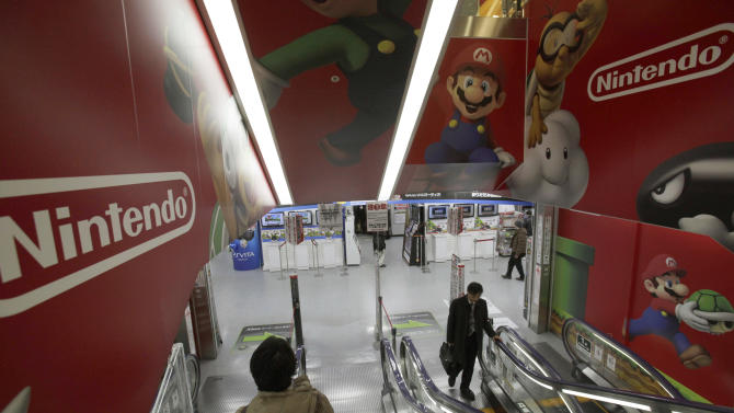 Shoppers take escalators under the logo of Nintendo and Super Mario characters at an electronics store in Tokyo, Wednesday, Jan. 30, 2013. Japanese video game maker Nintendo Co. has returned to the black for the first nine months of the fiscal year but remains pessimistic about sales prospects. The Kyoto-based maker of Super Mario and Pokemon games reported Wednesday that April-December profit totaled 14.55 billion yen ($160 million), a reversal from the 48.35 billion yen loss reported a year earlier. (AP Photo/Shizuo Kambayashi)