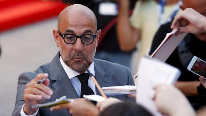 "American actor Tucci signs autographs during the red carpet for the movie ""Spotlight"" at the 72nd Venice Film Festival"
