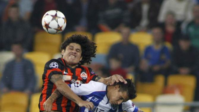 Shakhtar Donetsk's Marcio Azevedo goes for a header with Porto's Cristian Tello during their Champions League soccer match in Lviv