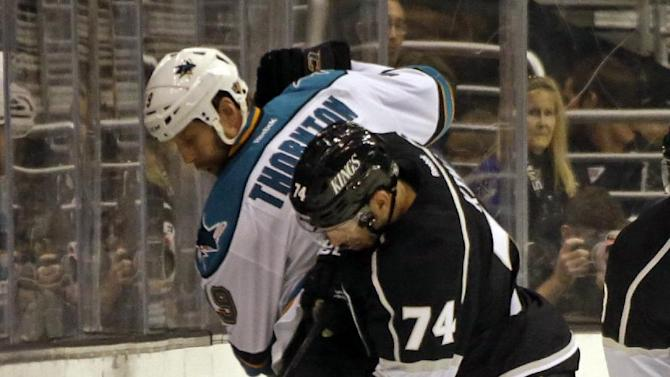 Los Angeles Kings center Dwight King (74) and San Jose Sharks center Joe Thornton in the second period of an NHL hockey game in Los Angeles Saturday, April 27, 2013. (AP Photo/Reed Saxon)