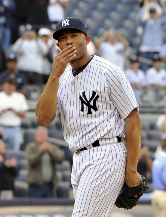 FILE - In this Sept. 19, 2011 file photo, New York Yankees' Mariano Rivera blows a kiss to the crowd to acknowledge cheers after recording his 602nd save as the Yankees beat the Minnesota Twins 6-4 in