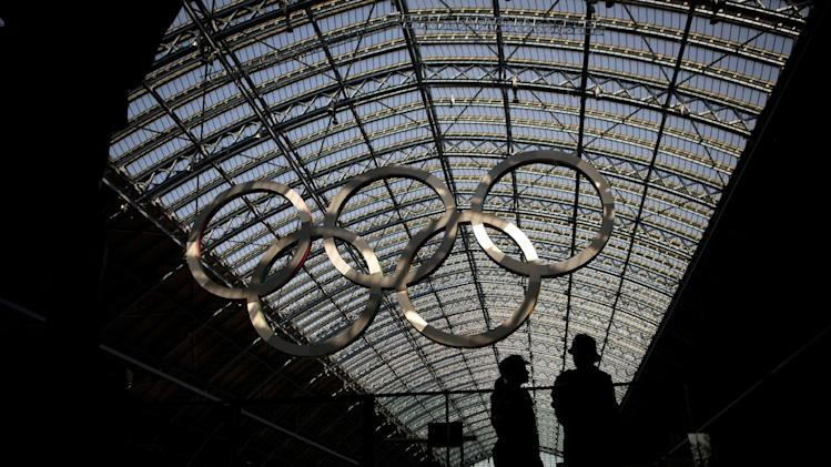 Two police officers patrol at St. Pancras Station in London, Thursday, July 26, 2012. Opening ceremonies for the 2012 London Olympics will be held Friday, July 27. (AP Photo/Emilio Morenatti)
