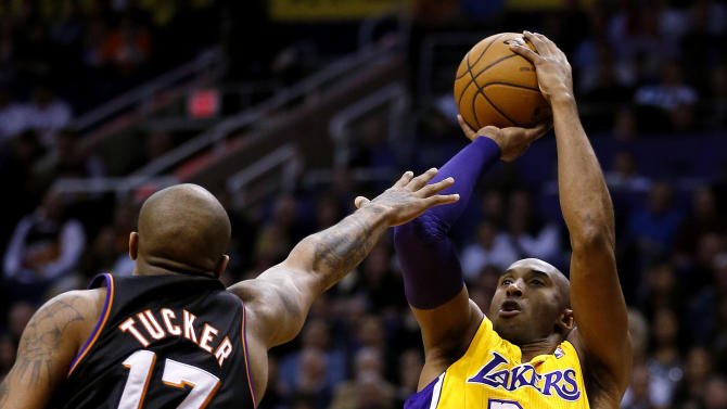 Los Angeles Lakers' Kobe Bryant (24) shoots over Phoenix Suns' P.J. Tucker (17) during the first half on an NBA basketball game, Wednesday, Jan. 30, 2013, in Phoenix. (AP Photo/Matt York)