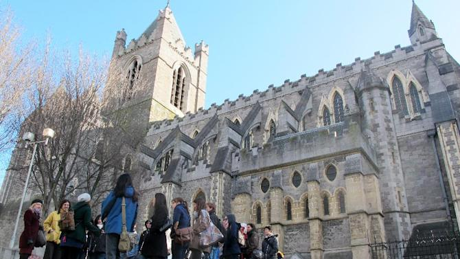 This March 4, 2012 photo shows an American tourist group gathered outside Christ Church Cathedral in Dublin. The 11th-century cathedral is a focal point for tourists exploring the medieval Viking origins of Dublin more than a millennium ago. (AP Photo/Shawn Pogatchnik)