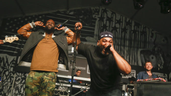 De La Soul's Kevin Mercer and Vincent Mason, from left, join Damon Albarn, right during the SXSW Music Festival Friday March 14, 2014, in Austin, Texas. (Photo by Jack Plunkett/Invision/AP)
