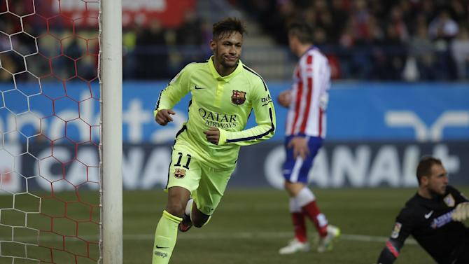 Barcelona's Neymar, left, celebrates his second goal during a second leg quarterfinal Copa del Rey soccer match between Atletico de Madrid and FC Barcelona at the Vicente Calderon stadium in Madrid, Spain, Wednesday, Jan. 28, 2015. (AP Photo/Andres Kudacki)