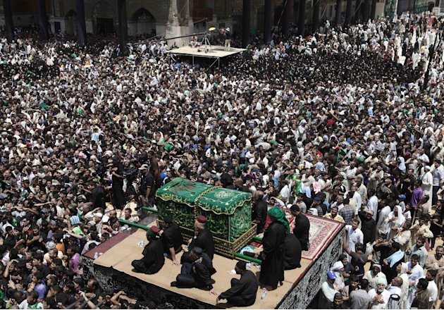 Shiite pilgrims carry a symbolic coffin at the holy shrine of the Imam Moussa al-Kadhim during the annual commemoration of the saint's death in the Shiite district of Kazimiyah, in Baghdad, Iraq, Satu