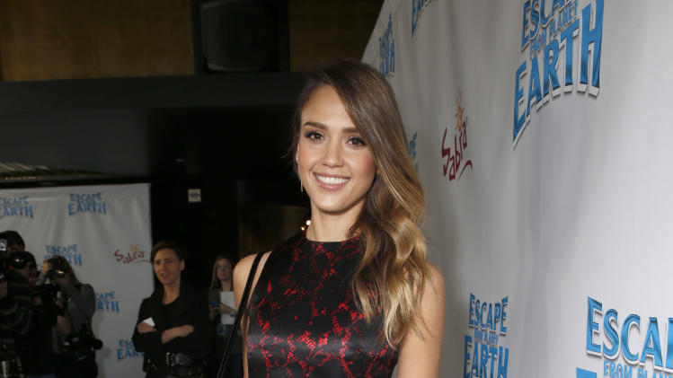 "Jessica Alba attends the LA premiere of ""Escape from Planet Earth"" at the Chinese Theater on Saturday, Feb. 2,2013 in Hollywood. (Photo by Todd Williamson/Invision/AP Images)"