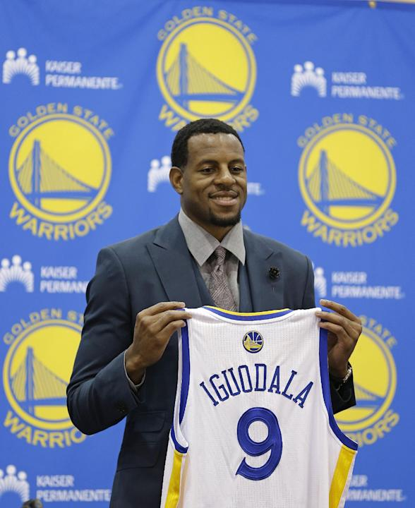 In this July 11, 2013, file photo, Andre Iguodala poses with his jersey after being introduced by the Golden State Warriors NBA basketball team at a news conference in Oakland, Calif. Iguodala said We