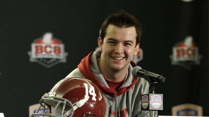 Alabama quarterback AJ McCarron smiles as he speaks during a news conference, Thursday, Jan. 3, 2013 in Fort Lauderdale, Fla. Alabama will play Notre Dame on Jan. 7 in the NCAA college football BCS Championship game. (AP Photo/Wilfredo Lee)