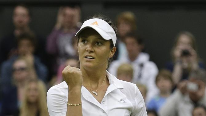 Laura Robson of Britain reacts after scoring a point against Mariana Duque-Marino of Colombia in their Women's second round singles match at the All England Lawn Tennis Championships in Wimbledon, London, Friday, June 28, 2013. (AP Photo/Anja Niedringhaus)