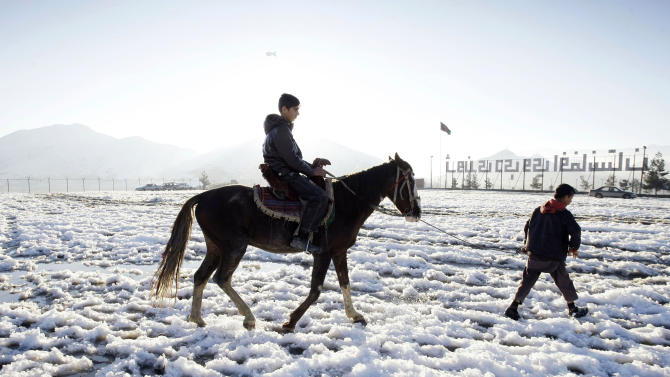 """In this Wednesday, Feb. 6, 2013 photo, Afghan actor Fawad Mohammadi 14, rides a horse on Nader Khan's hill at the one of the areas where a part of the Afghani Oscar Nominee film titled """"Buzkashi Boys,"""" shot in Kabul, Afghanistan. Fawad Mohammadi has spent half his life peddling maps and dictionaries to foreigners in the main tourist district in Kabul. Now the 14-year-old Afghan boy with beautiful green eyes is getting ready for his first airplane ride and a trip down the red carpet at the Oscars. (AP Photo/Musadeq Sadeq)"""