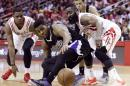 Sacramento Kings' Jason Thompson, center is between Houston Rockets Terrence Jones, left, and James Harden chasing after a loose ball in the second half of an NBA basketball game Wednesday, April 1, 2015, in Houston. The Rockets won 115-111. (AP Photo/Pat Sullivan)