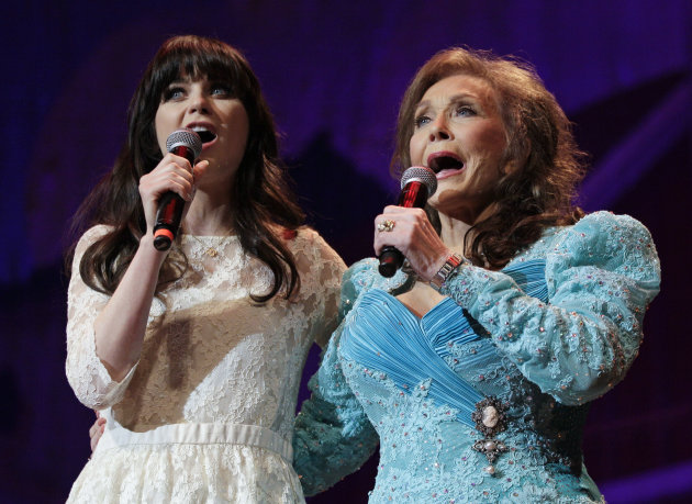 Country music star Loretta Lynn, right, and actress Zooey Deschanel sing Lynn&#39;s hit &quot;Coal Miner&#39;s Daughter&quot; during a performance of the Grand Ole Opry on Thursday, May 10, 2012, in Nashville, Tenn. During her appearance on the show, Lynn announced that a musical of &quot;Coal Miner&#39;s Daughter&quot; is in development and Deschanel will play her. (AP Photo/Mark Humphrey)