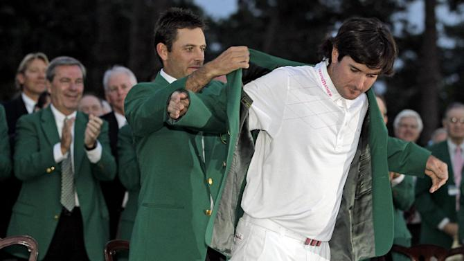 FILE- In this April 8, 2012, file photo, Charl Schwartzel, left, of South Africa, helps Bubba Watson put on the winner's green jacket after winning the Masters golf tournament on the 10th hole after a sudden death playoff in Augusta, Ga. Among the most pressing question for 2013: What will Watson serve for dinner at the Masters? (AP Photo/Darron Cummings, File)
