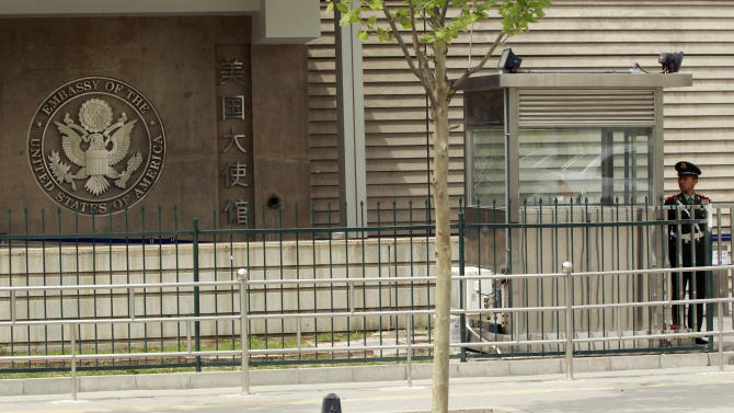 A Chinese paramilitary police officer stands guard at the entrance of the U.S. Embassy in Beijing, China, Sunday, April 29, 2012.  Chen Guangcheng, a blind legal activist who escaped house arrest in his rural Chinese village, is under the protection of American officials, activists said Saturday, creating a diplomatic dilemma for the U.S. and China days ahead of a visit by Secretary of State Hillary Rodham Clinton.  (AP Photo/ Vincent Thian)