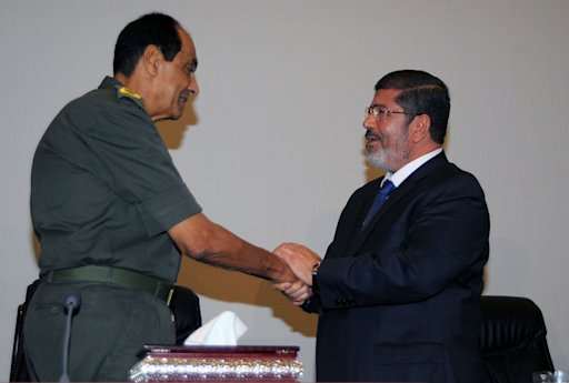 Egypt's President Mohamed Mursi greets Field Marshal Hussein Tantawi at the presidential palace in Cairo