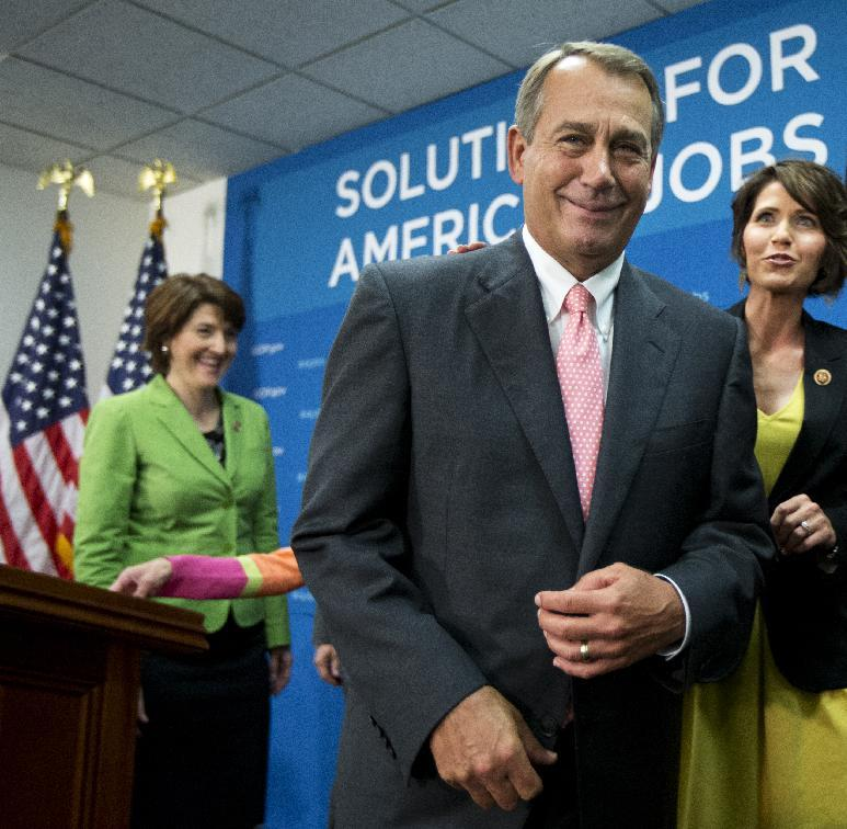 House Speaker John Boehner of Ohio, center, accompanied by House Republican Conference Vice Chair Rep. Cathy McMorris Rodgers, R-Wash., left, and Rep. Kristi Noem, R-S.D., leaves a news conference on Capitol Hill in Washington, Wednesday, June 12, 2013.    (AP Photo/Manuel Balce Ceneta)
