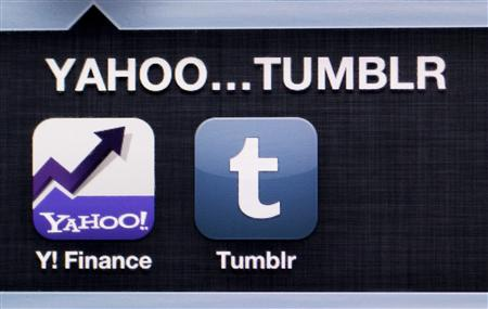 A photo illustration shows the applications of Yahoo and Tumblr on the screen of an iPhone in Zagreb