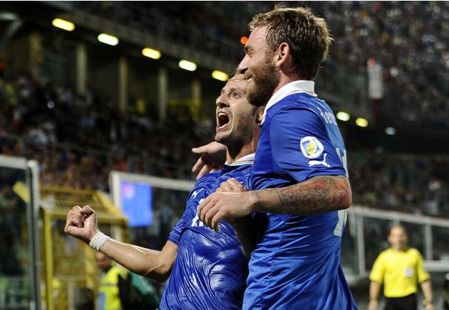 Italy's Gilardino celebrates with his team mate De Rossi after scoring against Bulgaria during their World Cup qualifying soccer match at the Renzo Barbera Stadium in Palermo
