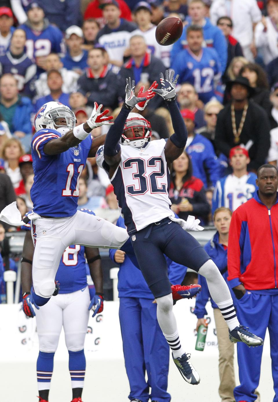 New England Patriots' Devin McCourty (32) intercepts a pass intended for Buffalo Bills' T. J. Graham (11) during the first half of an NFL football game in Orchard Park, N.Y., Sunday, Sept. 30, 2012. (AP Photo/Bill Wippert)