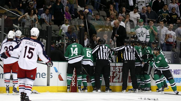 Columbus Blue Jackets and Dallas Stars players rush to the bench in the first period of an NHL Hockey game Monday, March 10, 2014, in Dallas. Stars center Rich Peverly was transported to the hospital after play was suspended. (AP Photo/Sharon Ellman)