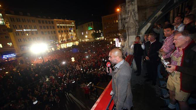 In this picture taken Saturday May 10, 2014,  Bayern Munich soccer coach Pep Guardiola speaks to fans on the balcony of the city hall  during celebrations for Bayern's  Champions' title   in Munich , Germany