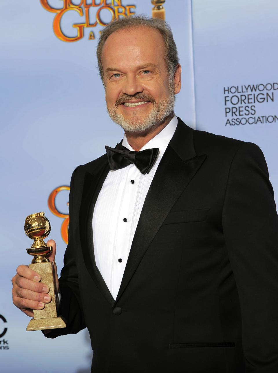 "Actor Kelsey Grammer poses backstage with the award for Best Actor in a TV Series Drama for the series ""Boss"" during the 69th Annual Golden Globe Awards Sunday, Jan. 15, 2012, in Los Angeles. (AP Photo/Mark J. Terrill)"