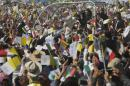 Catholic faithful cheer as Pope Francis drives by in his popemobile in Ecatepec, Mexico, Sunday, Feb. 14, 2016. Pope Francis will give a Mass at an outdoor field in the capital's suburb of Ecatepec to an estimated crowd of 400,000 pilgrims. It is to be his biggest event during his trip to Mexico. (AP Photo/Marco Ugarte)