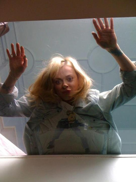 Celebrity photos: When Fearne went on a photoshoot in a house with glass floors this week, she couldn't resist lying down and pressing her face against it for a hilarious snap. [Copyright: Fearne Cott
