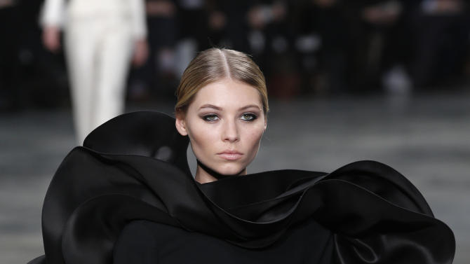 A model presents a creation by French fashion designer Stephane Rolland  for his Spring Summer 2013 Haute Couture fashion collection, presented in Paris, Tuesday, Jan.22, 2013. (AP Photo/Christophe Ena)