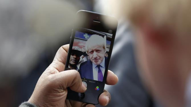 A man takes a selfie with London Mayor Boris Johnson during campaigning for the local parliamentary seat in Uxbridge