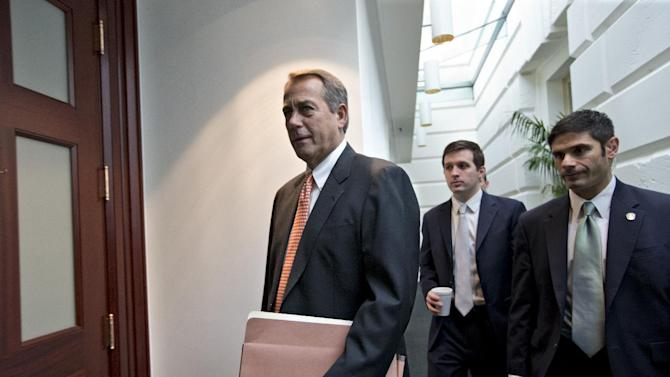 """House Speaker John Boehner of Ohio, who spoke with President Barack Obama yesterday, arrives for a closed-door meeting with the GOP caucus, Wednesday, Dec. 12, 2012, on Capitol Hill in Washington. Boehner and the other House Republican leaders are calling for Obama to come up with plan they can accept for spending cuts and tax revenue to avoid the so-called """"fiscal cliff"""" of automatic tax hikes and budget reductions. (AP Photo/J. Scott Applewhite)"""