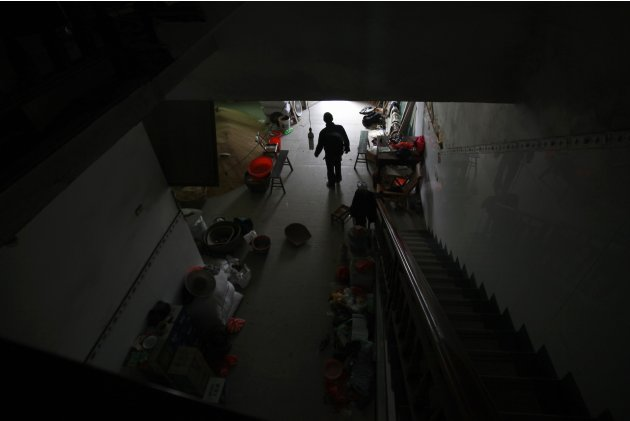 Luo walks in his house which stands alone in the middle of a newly built road in Wenling