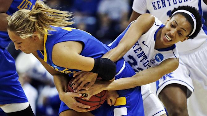 Kentucky guard Kastine Evans, right, wrestles Delaware guard Kayla Miller for the ball during the first half of a regional semifinal in the NCAA college basketball tournament in Bridgeport, Conn., Saturday, March 30, 2013. (AP Photo/Charles Krupa)
