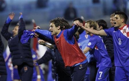 Croatia's Nikica Jelavic celebrates with teammates after winning against Serbia during their 2014 World Cup qualifying soccer match at Maksimir stadium in Zagreb