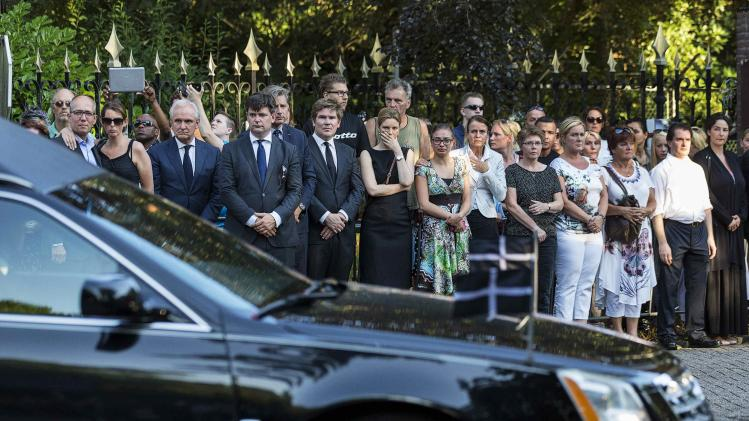Family members of the victims killed in Malaysia Airlines Flight MH17 plane disaster react as a row of hearses carrying the victims' bodies arrives at the Korporaal van Oudheusden barracks in Hilversum