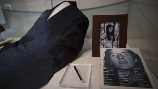 "A picture of Argentina's late President Nestor Kirchner, right, his pen, his suit and a picture of his wife, current President Cristina Fernandez, top, sit on display at the Bicentennial Museum in Buenos Aires, Argentina, Wednesday, Nov. 21, 2012.  A documentary film titled ""Nestor Kirchner"" hits the theaters on Thursday, the latest example of an ongoing effort to exalt the late president's memory, seeking to match the level of Juan Domingo Peron.  Streets, hospitals, tunnels and even a soccer tournament is named after Nestor Kirchner, who served as president from 2003 to 2007 and died at the age of 60 on Oct. 27, 2010. (AP Photo/Natacha Pisarenko)"