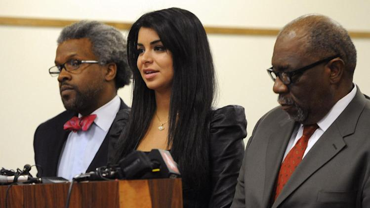 Todd Russell Perkins, left,  Highland Park City Attorney and W. Otis Culpepper, defense attorney, flank ex-Miss USA Rima Fakih as she faces DUI charges in 30th District court, before Judge Brigette Officer, in Highland Park, Mich., Wednesday, April 11, 2012.  Fakih pleaded no contest Wednesday in a Michigan drunken driving case. The former beauty queen offered the plea to driving while visibly impaired. A no contest plea isn't an admission of guilt but is treated as such for sentencing, which will take place May 9. She faces a maximum of 93 days in jail.   (AP Photo/The Detroit News, Charles V. Tines)