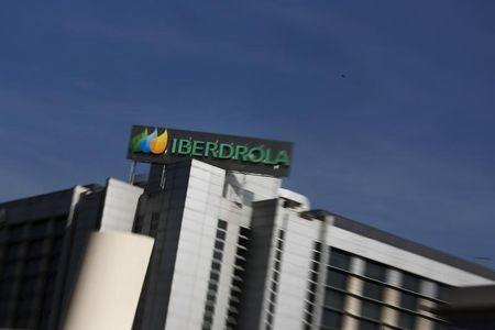 The logo of Spanish power company Iberdrola is seen on top of Iberdrola's main office building in Madrid