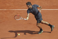 Roger Federer of Switzerland returns in his second round match against Adrian Ungur of Romania at the French Open tennis tournament in Roland Garros stadium in Paris, Wednesday May 30, 2012. (AP Photo/Michel Spingler)
