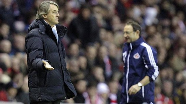 Roberto Mancini reacts as Martin O'Neill watches on during Manchester City's 1-0 Boxing Day defeat at Sunderland