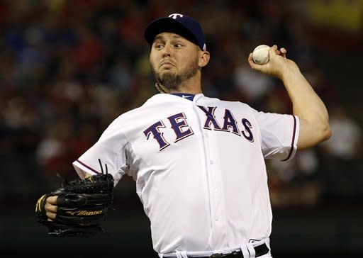 Harrison wins 16th game, Texas beats Indians 6-4
