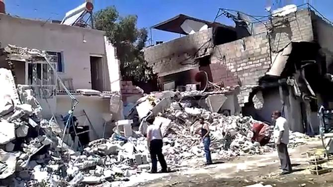 This citizen journalism image provided by Ugarit News, taken on Monday, July 23, 2012, purports to show damage from heavy shelling of the al-Qadam district of Damascus, Syria. (AP Photo/ Ugarit News) THE ASSOCIATED PRESS IS UNABLE TO INDEPENDENTLY VERIFY THE AUTHENTICITY, CONTENT, LOCATION OR DATE OF THIS CITIZEN JOURNALIST IMAGE