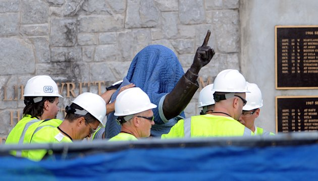 Penn State Office of Physical Plant workers cover the statue of former football coach Joe Paterno near Beaver Stadium on Penn State&#39;s campus in State College, Pa., on Sunday, July 22, 2012. The university announced earlier Sunday that it was taking down the monument in the wake of an investigative report that found the late coach and three other top Penn State administrators concealed sex abuse claims against retired assistant coach Jerry Sandusky. (AP Photo/Centre Daily Times, Christopher Weddle) MANDATORY CREDIT; MAGS OUT