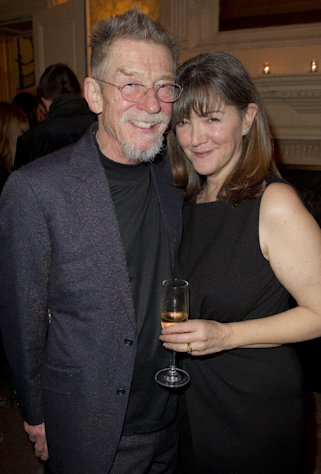 British actor John Hurt and wife Anwen Rees Meyers pose for photographs during a pre Bafta drinks reception for director Martin Scorsese at Claridges in London, Friday, Feb. 10, 2012. Scorsese receives the Bafta Fellowship award during the ceremony on Sunday. (AP Photo/Joel Ryan)