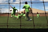 Undocumented immigrants play a game of soccer at the U.S. Immigration and Customs Enforcement (ICE) detention facility for illegal immigrants in 2010 in Florence, Arizona. US President Barack Obama suspended the threat of deportation against hundreds of thousands of young illegal immigrants Friday, delighting crucial Hispanic voters ahead of November&#39;s election