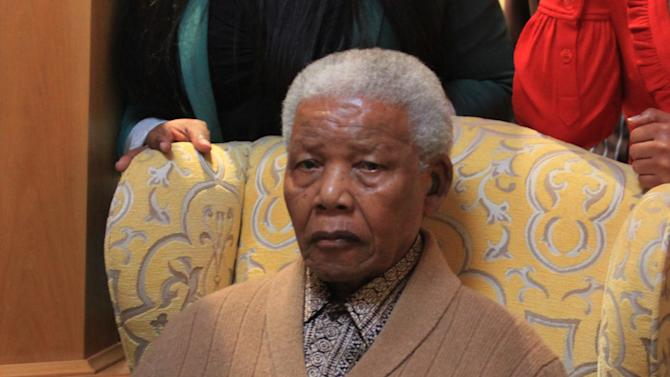 FILE - In this Wednesday May 30, 2012 file photo South Africa's former president Nelson Mandela, after receiving a torch to celebrate the African National Congress' centenary from ANC chairperson Baleka Mbete in Mandela's home village of Qunu in rural eastern South Africa. The South African presidency says Nelson Mandela was re-admitted to hospital with a recurrence of a lung infection Thursday March 28, 2013.  (AP Photo/Lulamile Feni-Daily Dispatch) SOUTH AFRICA OUT