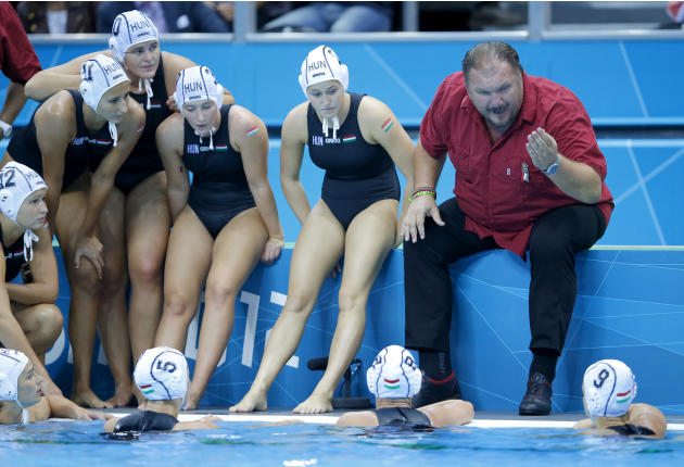 Hungary's head coach Meresz talks with his team during a time out as they met Spain in their Women's Semifinal water polo match during the London 2012 Olympic Games